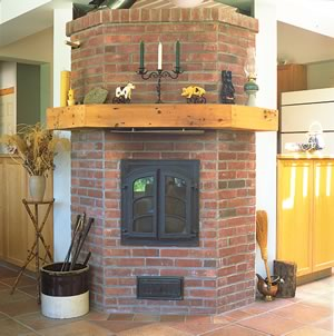 The wood fired masonry heater only needs tending every 24 hours. Photo by Robin Stubbert.