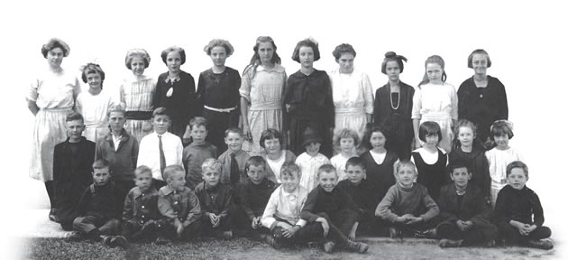 Alex (front row, third from right) met his wife June Gillespie (second row, fifth from right) in 1918 when they were both in kindergarten at SS # 8 in Caledon Billage. This school picture was taken in 1921. June first married Alex's best friend, Ralph Stubbs (left of Alex). Alex and June were married in 1976, following the death of Ralph and Alex's first wife, Doris.