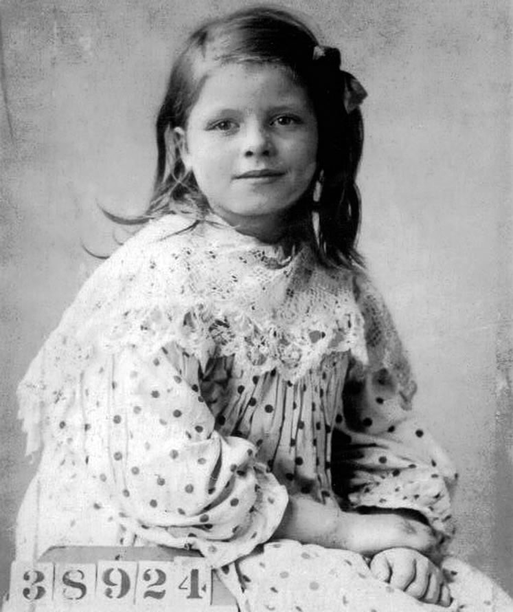 This picture of young Hilda Williams was taken on the day she entered a Barnardo home, which photographed and assigned a number to each child in its care.