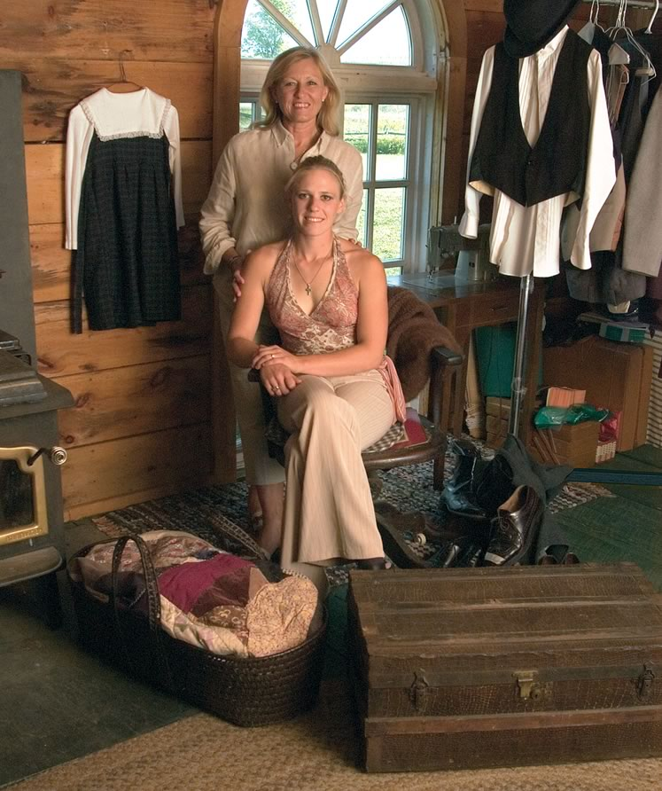Barb Perkins and her daughter, Briar, amid props for home child, including a trunk that accompanied a child from the Barnardo homes to canada. Briar will play her own great-grandmother in her mother's musical production. Photo by Tom Partlett.