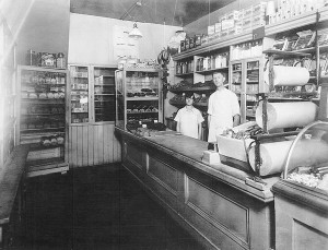 "Ira Eby and his wife Mary Ann (c.193o) in the store he ran in Horning's Mills for thirty-five years. Local history has it that a friend and supplier in Toronto delivered goods to the store by airplane – perhaps one of the reasons the store continued to provide ""almost everything,"" even after automobile travel made it easy for villagers to drive to bigger stores in Shelburne. Photo Courtesy Dufferin County Museum And Archives."