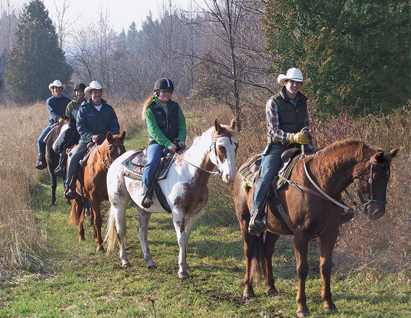 Young people enjoy an autumn ride along the ranch's trails. Photo Courtesy Teen Ranch.
