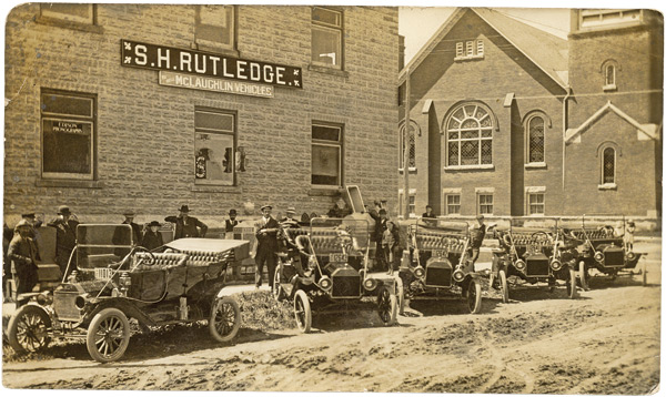 The S.H. Rutledge opened an early dealership on Owen Sound Street in Shelburne (shown c. 1920), selling McLaughlan automobiles. Photo Courtesy Dufferin County Museum And Archives.