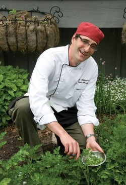 "Chef Roberto cooks with ""fl are"" in the Millcroft kitchen, and gathers fresh herbs from the inn's own kitchen garden. Photo by Pete Paterson."