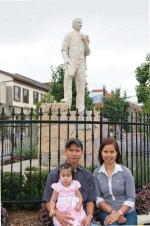 Gerelyn and Rex Tabsing take Rex's daughter Sophia for a walk along Broadway. The sister and brother founded Orangeville's Filipino Community group to help immigrants adjust to their new home. Photo by Pete Paterson.