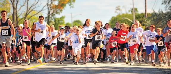 Children take part in the Kids 1 Mile race as part of the Running Festival.