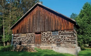The Nelsons used this unusual cedar-block barn, c1834, as a piggery. It still stands on the property.