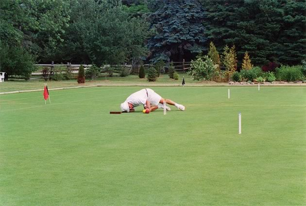 Bob Wille takes a closer look at his options during a Tricky Wicket competition. Photo Caledon Croquet Club