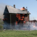 It took only minutes for fire to destroy this farmhouse on Hwy. 24, north of Horning's Mills, as documented by photographer Harold Whyte.