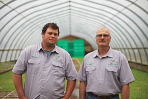 """Bill French (right) and son Brian grow rhubarb, peas and other vegetables for the Toronto market at Lennox Farm, beside the quarry site. Bill's father farmed in Brampton and sold when subdivisions and golf courses moved in. A generation before, his grandfather farmed on Islington Avenue in what is now built-up Toronto. Bill feels lucky to have found this 3oo-acre patch of paradise near Reddickville in 1988 after combing the province for the best soil. Bill hopes Brian and his one-year-old son won't be the next generation to pick up and move: """"There's no other place to go."""" Photo Jason Van Bruggen"""