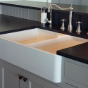 The wash-up island boasts a porcelain under-mounted double farm sink and a built-in dishwasher. Photo MK Lynde