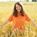 """Fields of gold, Karen Hutchinson in a neighbour's wheat field: """"It is my goal to get conventional wheat fields turned into fife."""""""