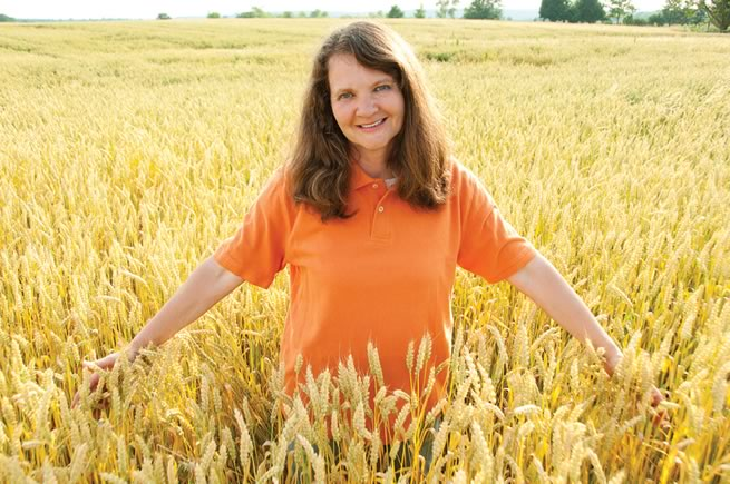 Karen Hutchinson in a neighbour's wheat field