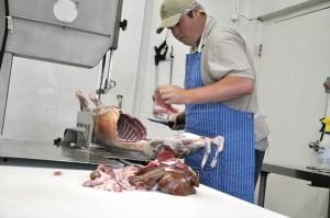 Dane Metheral prepares lamb, the abattoir's primary product. Photo by Trina Berlo