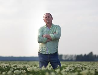 Canadian Chef's Congress president Michael Stadtländer standing in a Melancthon Township potato field. Photo by Jason Van Bruggen
