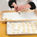 Roll each piece along the back of a floured fork to create a marked gnocchi. Or form into 1-inch balls and press with a floured thumb. Place the gnocchi on lightly floured baking sheets and cover with a clean tea towel. Chill for 3 hours before cooking. Photo by Pete Paterson
