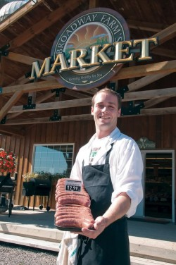 "Jordan Livingston, has become the ""Sausage King"" of Broadway Farm's Market on Heart Lake Road. Photo by Pete Paterson"