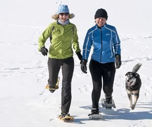 Barb Campbell (left) and Nicola Ross in snowshoes. Photo by Pete Paterson
