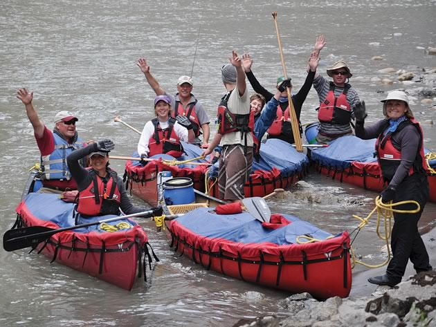 The group cheers after running the formidable Cache Creek Canyon, Mountain River.