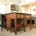 An antique secretary's desk forms the kitchen island's base. Photo by Pete Paterson.