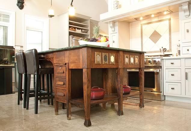 An antique secretary?s desk forms the kitchen island?s base Photo