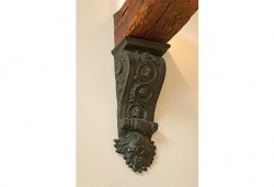 A cast-iron corbel supports an old barn beam. Photo by Pete Paterson.