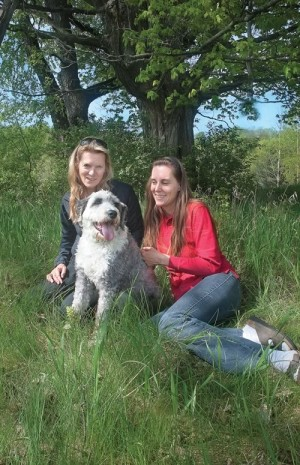 """Writer Monica Duncan (left) enlisted the help of Claudia Hehr to """"talk"""" with rescue dog Gus about his anxieties, and Gus obliged. Photo by Rosemary Hasner."""