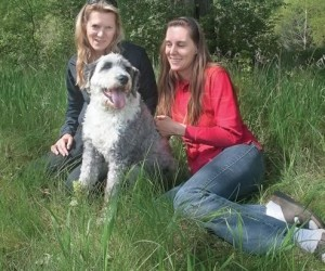 """Writer Monica Duncan (left) enlisted the help of Claudia Hehr to """"talk"""" with rescuedog Gus about his anxieties, and Gus obliged. Photo by Rosemary Hasner."""