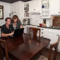 Nathan Hathaway and Brenda Gray also finished a recent kitchen renovation that involved removing walls in their condo, creating enough space to host a recent family dinner for 18. Photo by Rosemary Hasner.
