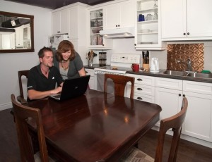 Nathan Hathaway and Norm Gray also finished a recent kitchen renovation that involved removing walls in their condo, creating enough space to host a recent family dinner for 18. Photo by Rosemary Hasner.