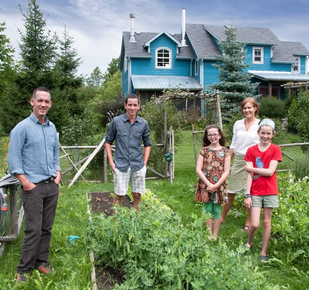 Filmmaker Michael McGowan with his wife Shelagh McNulty and kids Henry, 13, Frances, 9, and Wiley, 11, in the vegetable garden outside the Mulmur house McGowan helped design and build. Photo by Pete Paterson.