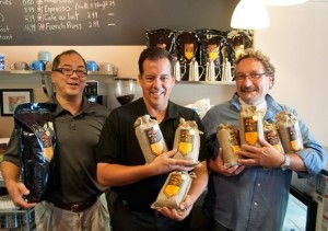 Hockley Valley Coffee Roasters' proprietor Tom Deans shows off his wares in La Pologne, an Orangeville café and deli, flanked by roast master Wallace Mark (left) and sales manager Harry Feinig. Photo by Pete Paterson.