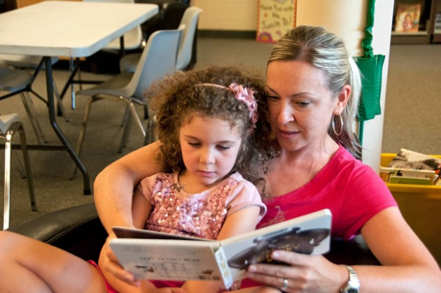 Leyla and her mom are absorbed by a picture book. Photo by Pete Paterson.