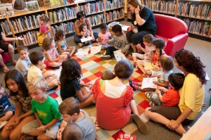 Young kids and their parents enjoy the regular drop-in story and craft time at Albion Bolton branch. Photo by Pete Paterson.