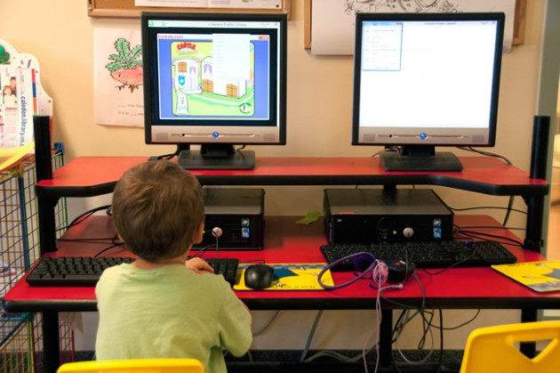A youngster checks out a computer game. Photo by Pete Paterson.