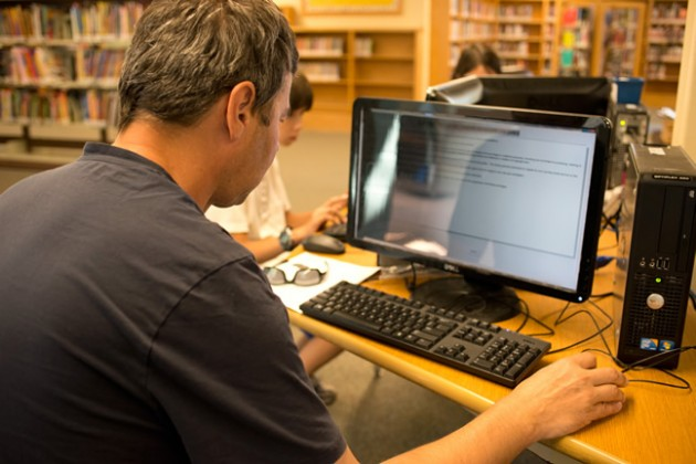 Library patrons can use the library computer stations the same way they browse books. Photo by Pete Paterson.