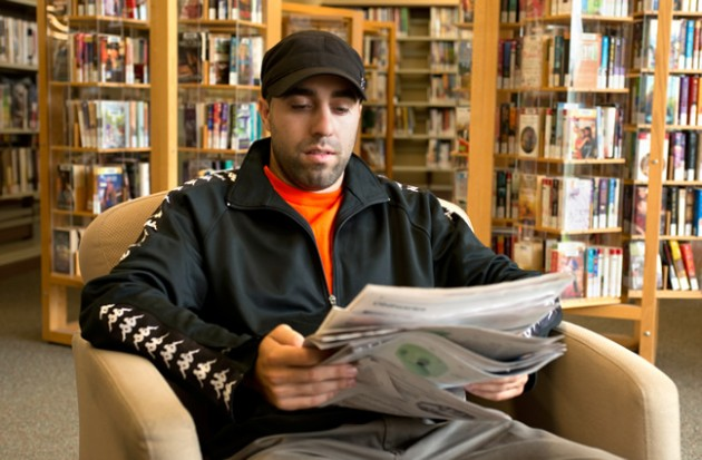Kids' group leader Leo Scardicchio takes a break to catch up on the news. Photo by Pete Paterson.