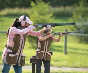 "Pearl Willems and Elaine Crawford fi re at ""birds"" during the weekly Ladies' Trap Shooting Night. Photo by Pete Paterson."