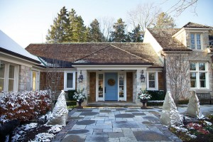 With a simple wreath and a dusting of snow, the Erin stone house seems made for Christmas.