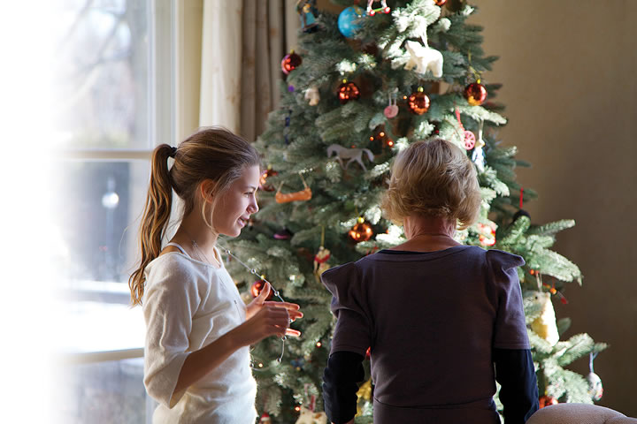 The tree is covered with decorations made by many little hands over the years and tells an ongoing story of children and grandchildren.