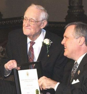Alex Raeburn, left, accepts his award from the Honourable David C. Onley.