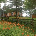 Orange day lilies bloom as they always have outside SS#1 Stanton, now a private home. Photo by Rosemary Hasner / Black Dog Creative Arts.