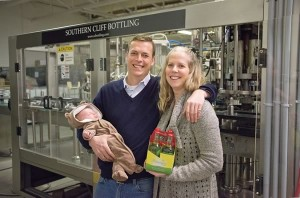 Nick and Lindsay Sutcliffe with daughter Madeline at 3 weeks; their cider is made exclusively from fresh Ontario apples at the Southern Cliff bottling plant. Photo by Pete Paterson.