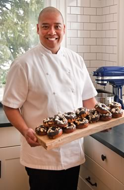 Caesar Guinto is the chef/owner at Creemore Kitchen is an expert doughnut maker.