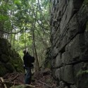 The moss-covered stonewall corridor