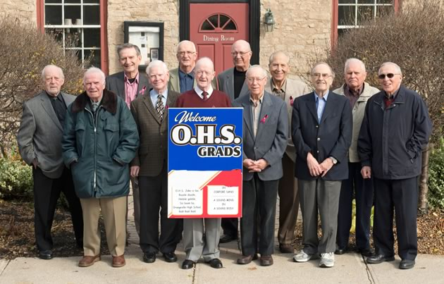 More than half a century later, grads of Orangeville High School still meet regularly for lunch and conversation. Left to right: Mel Rennick, Donny Evans, Stan Stych, Jim Wardlaw, Danny Webb, Jim Welsh, Ed Nodwell, David Scott, Martin Dambeau, Bill Waters, Ron Coles, Jimmy Lot. Photo by Pete Paterson.