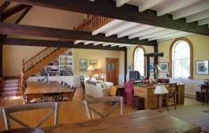 The upper hall leads to a series of small bedrooms and a study that is open to the living space below.