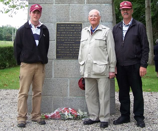Three generations: James, Thomas and David Jackson standing at the crossroads in France that Thomas helped defend as part of the Normandy assault on the morning of June 6, 1944.