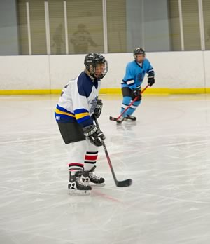 It was my first time on hockey skates and my first time using a hockey stick on ice. Not very Canadian, eh? But true. Photo by Pete Paterson.