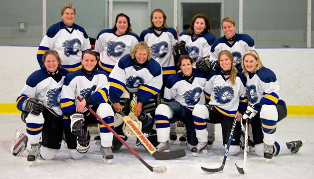 Writer Nicola Ross looks every bit the part in her debut hockey game. She even did a turn in goal and grinned happily (perhaps with relief it was over) front and centre for the team photo. Photo by Pete Paterson.